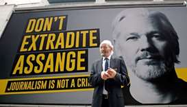 Assange warned he will be removed from extradition hearings if outbursts continue