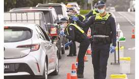 Police check the details of drivers in the small regional town of Kilmore, some 60km north of Melbou