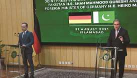 Pakistani Foreign Minister Shah Mahmood Qureshi (right) speaks next to German counterpart Heiko Maas