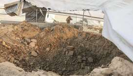A Palestinian man inspects the damage following reported Israeli air strikes on Rafah in the souther