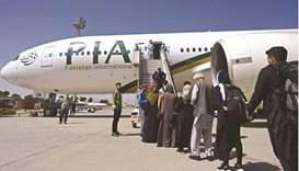 Passengers board the Pakistan International Airlines (PIA) flight at the airport in Kabul.