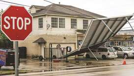 A carport hangs from power-lines after Tropical Storm Nicholas moved through the area in Houston, Te