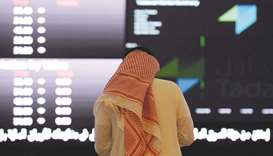 A Saudi investor monitors share prices at the Saudi Stock Exchange, or Tadawul, in the capital Riyad