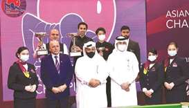 India's Pankaj Advani (top second left) celebrates on the podium with other winners and officials af