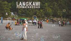 Visitors flocked to the Malaysian island of Langkawi yesterday as it became the country's first holi