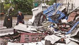 Rescuers clean up debris after a 5.4 earthquake that killed three and injured a dozen in Luzhou, in