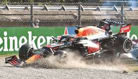 Red Bull's Max Verstappen and Mercedes' Lewis Hamilton crash out of the Italian Grand Prix in Monza,