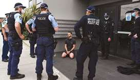 Police detain a man after checking his identification in Sydney following calls for an anti-lockdown