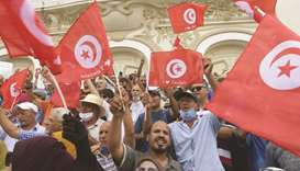 Tunisian demonstrators shout slogans against President Kais Saied during a protest in the capital Tu
