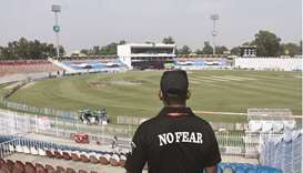 A member of the Police Elite Force stands guard at the Rawalpindi Cricket Stadium, after the New Zea