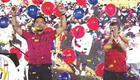 Philippine boxer-turned-politician Manny Pacquiao (left) gestures during the PDP-Laban national asse