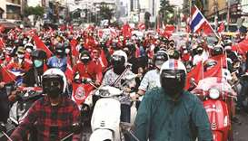 Anti-government protesters gather for a demonstration on scooters to mark the 15-year anniversary si