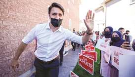 Canada's Liberal Prime Minister Justin Trudeau greets supporters at an election campaign stop on the