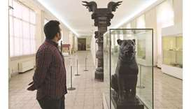 A man visits the National Museum of Iran, which houses exhibits from the early Paleolithic to the Qa