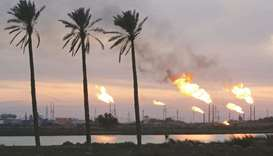 Flames emerge from flare stacks at the oil fields in Basra (file). According to the World Bank, Iraq