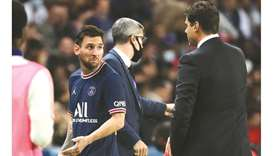 Paris Saint-Germain's Lionel Messi talks to head coach Mauricio Pochettino (right) after being subst