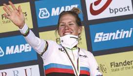 Netherlands' cyclist Ellen van Dijk celebrates on the podium after winning the time trial race of th