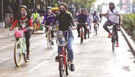 A member of an Afghanistan's robotics team, who arrived to Mexico last month, rides a bicycle at Mex