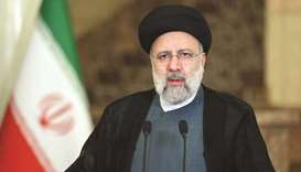 A handout picture provided by the Iranian presidency yesterday shows Iranian President Ebrahim Raisi