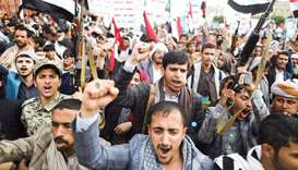 Supporters of Yemen's Houthis shout slogans during a rally to celebrate the seventh anniversary of t