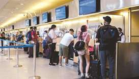 Travellers at an American Airlines check-in counter at Philadelphia International Airport (PHL) in P