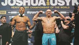 Anthony Joshua (left) and Oleksandr Usyk during the weigh-in at the The O2 Arena in London yesterday