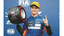 McLaren's Lando Norris celebrates pole position after qualifying at the Russian Grand Prix in Sochi,