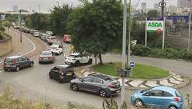 An aerial view shows customers queueing in their cars to access an Asda petrol station in east Londo