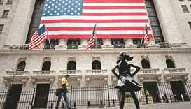(File photo) A man passes by the New York Stock Exchange building in Manhattan, in New York City, US