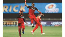 Harshal Patel (centre) of RCB celebrates his hat-trick during the IPL match against the Mumbai India