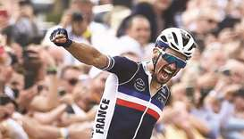 France's Julian Alaphilippe celebrates as he crosses the finish line to win the men's elite cycling
