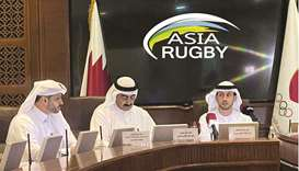 Qatar Rugby, Hockey and Cricket Federation President Yousef Jeham al-Kuwari (centre) during the draw
