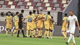 Al Gharafa players celebrate after their victory over Umm Salal in the QNB Stars League at the Kha