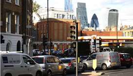 Vehicles queue to refill at a Shell fuel station in central London, Britain yesterday. REUTERS