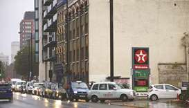 Vehicles queue to refill at a Texaco fuel station in London, Britain, yesterday.