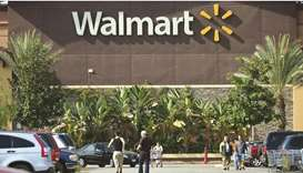 Shoppers are seen outside a Walmart store in Rosemead, California (file). US consumer confidence fel