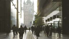 Workers walk towards Tower Bridge in London. More than 1mn British workers face an uncertain future
