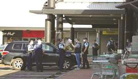Police respond to the scene of an attack carried out by a man shot dead by police after he injured m
