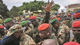 Guinea coup leader promises national government as politicians arrested
