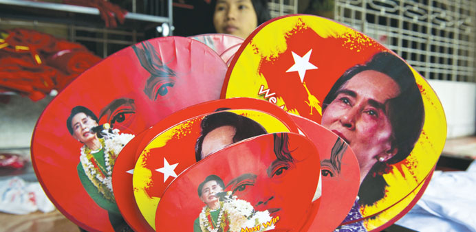Various fans with portraits of Myanmar opposition leader Aung San Suu Kyi are seen for sale outside
