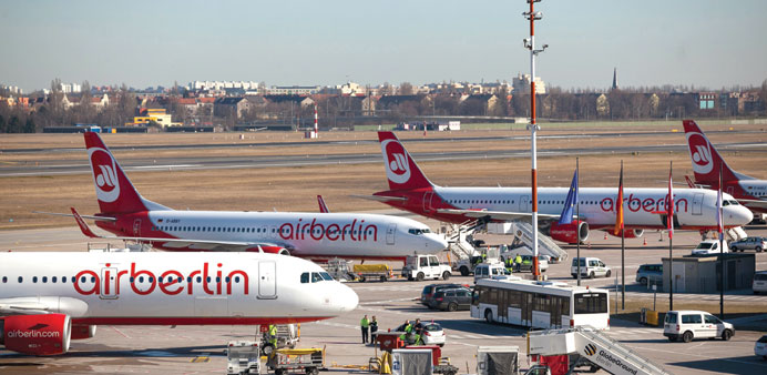 Air Berlin aircraft sit on the tarmac at Tegel airport in Berlin. Etihad Airways is raising its s