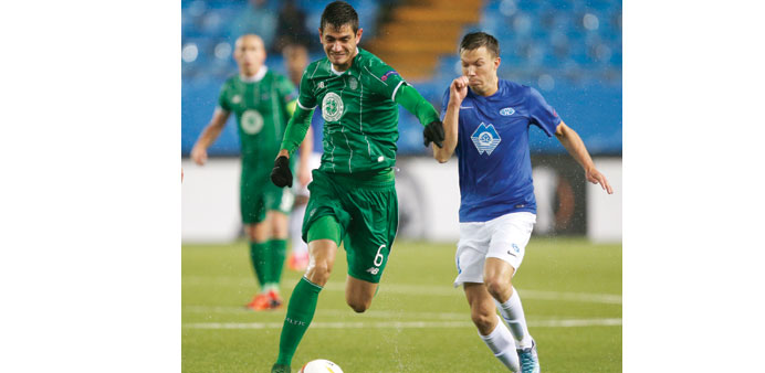 Celtic's Nir Biton and Molde's Martin Linnes vying for the ball during their Europa League match. (R