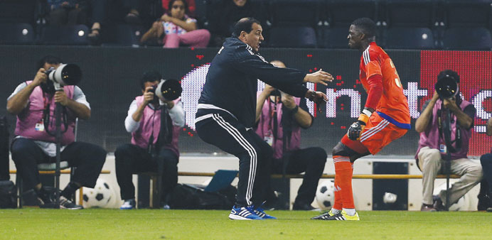 Sailiya goalkeeper Gregory Gomis (right) celebrates with a member of the training staff yesterday. P