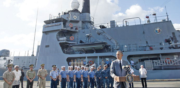US President Barack Obama speaks following a tour of the BRP Gregario Del Pilar in the Manila Harbou