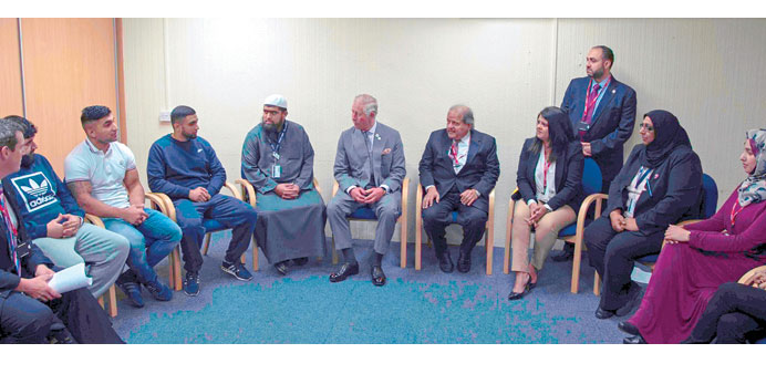Sheikh Faisal and Prince Charles interacting with a group
