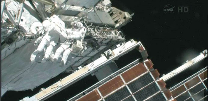 Spacewalking astronauts replace ISS leaky pump