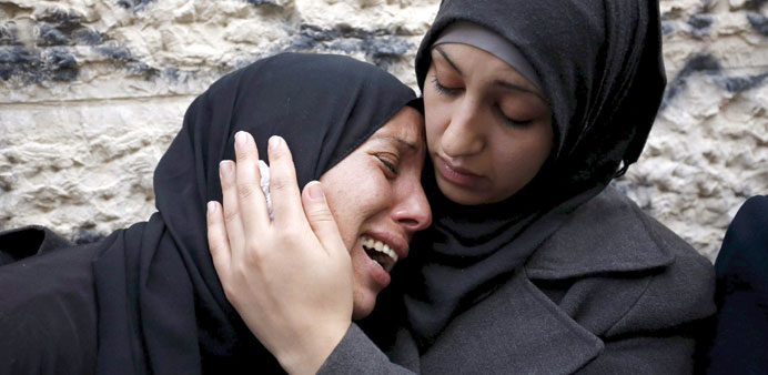 A relative of Palestinian Ahmed al-Ayesh, who was killed by Israeli troops yesterday, is comforted a