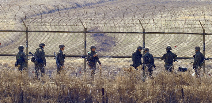 South Korean soldiers checking a military iron fence in the border city of Paju