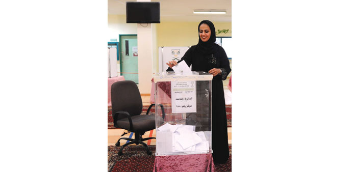 A woman casts her ballot at a polling station in Jeddah yesterday.