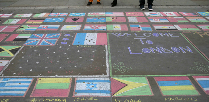 People look at a chalk mural drawn in remembrance of the victims of the Paris attacks